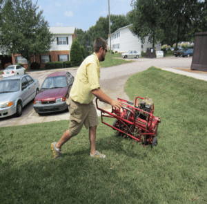 man aerating lawn
